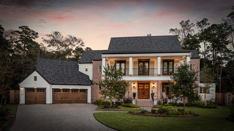 Traditional Texas Home with Balcony built by Frankel Building Group.