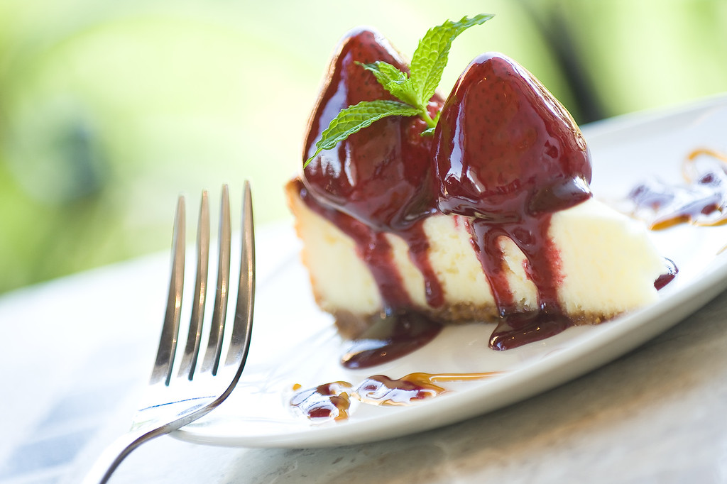 Chophouse: Cheesecake with strawberries and raspberry sauce.