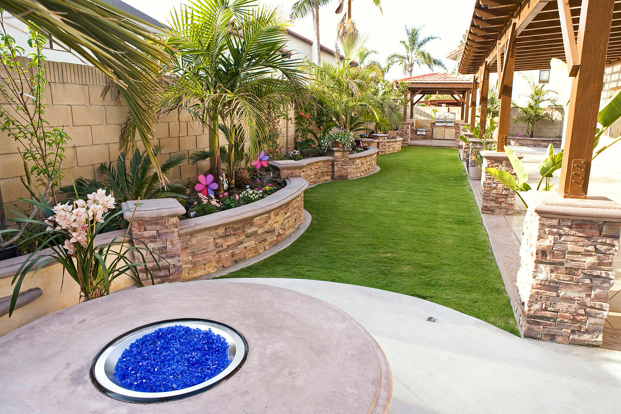 The back yard has an outdoor fire pit with blue glass crystals. It uses natural gas. A natural gas pipe line was run 2 feet from the main gas line from the front of the house to the fire pit and then it goes under the grass to the gazebo.