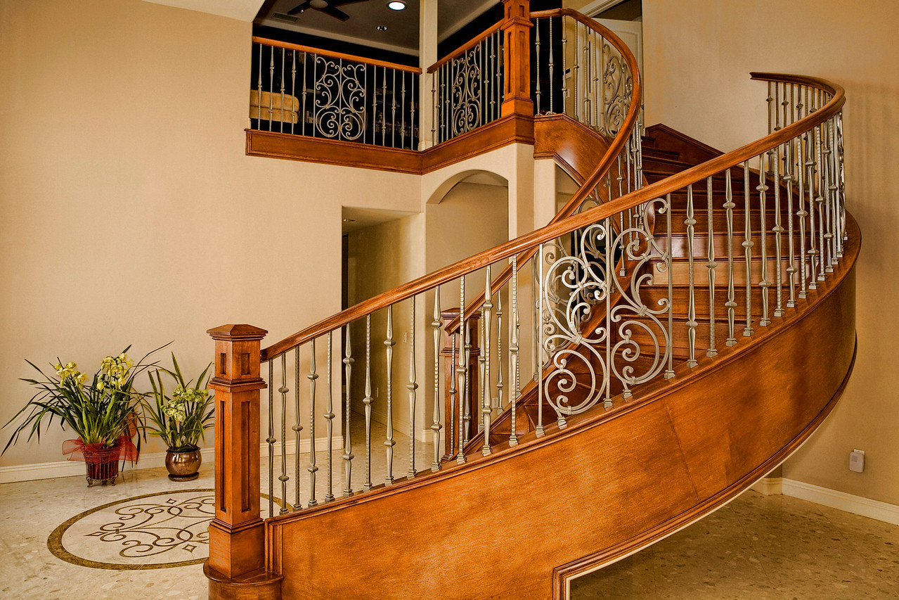 This staircase was the 3rd design that got built. <br /> Since there is no support in the middle of the stairs, each stringer (of the 2 sides) were built with 18 layers of 1/4 inches plywoods nailed and glued together. They have to be strong enough to support the entire staircase.<br /> The wrought Iron Balusters were electroplated or powder coated in silver metal finish, they were not painted.