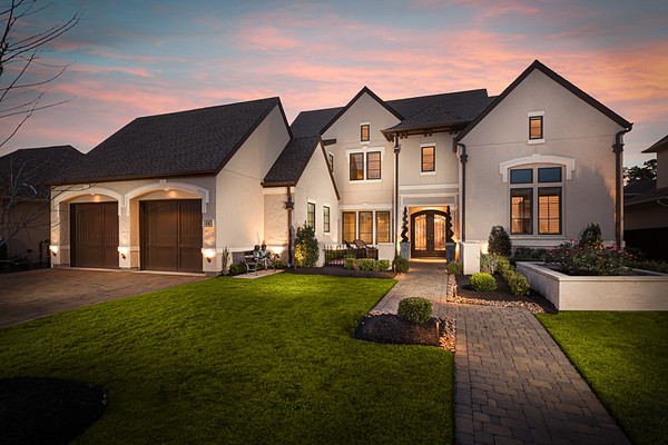 twilight photography of frankel building group of a house in the reserve in the woodlands