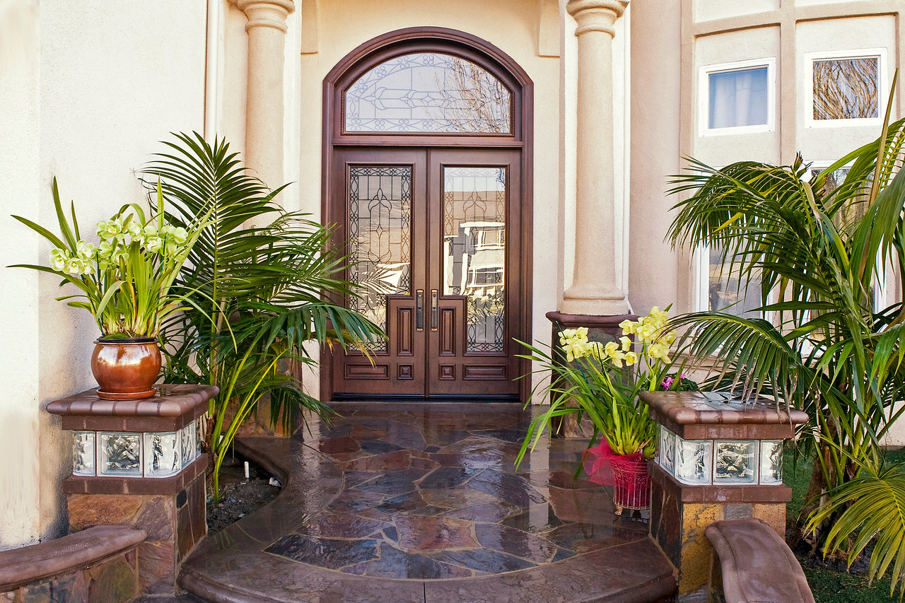 The front door is from the CAOBA's Wrought Iron Collection. The transom was pre-measured and customed ordered from CAOBA.