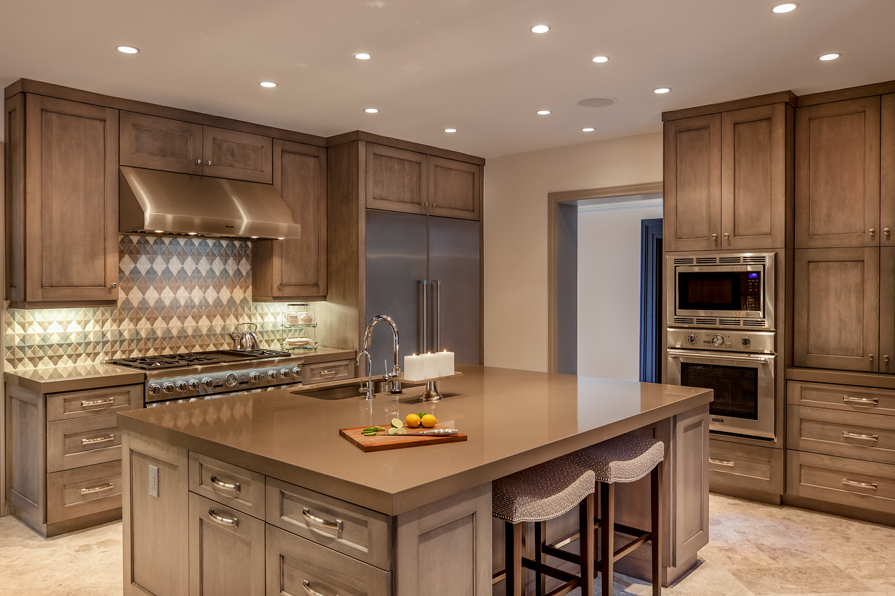 grey brown wood kitchen design with large kitchen island and tiled backsplash houston architectural photographer   connie anderson photography  rh   connieandersonphotography com