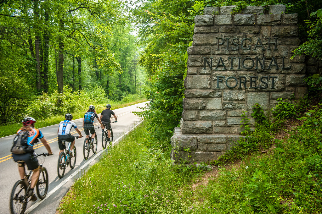 Riders enter into Pisgah National Forest heading for epic single track accessed right from downtown Brevard, North Carolina.