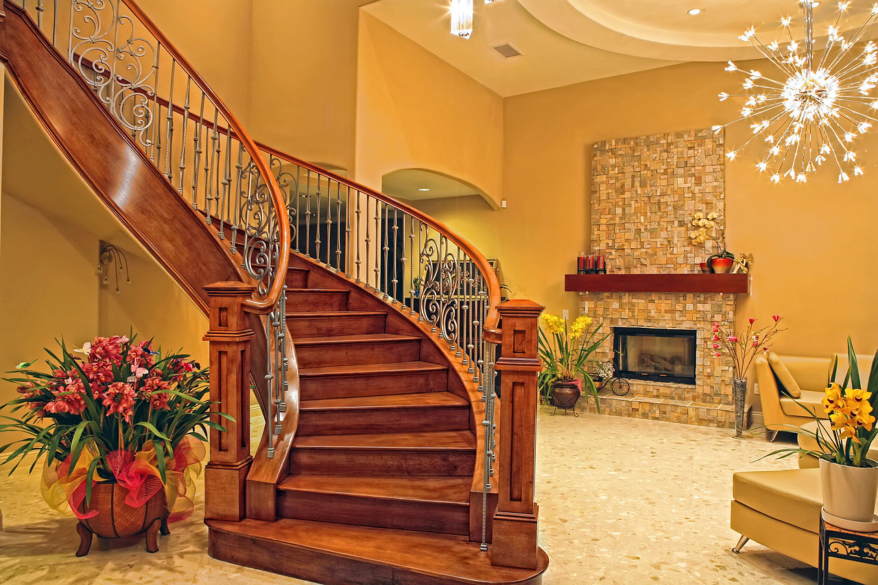 The staircase was built with Maple solid woods. They were color stained with a touch of highlight.<br /> After that, several polyurethane varnish coats were applied for protection.<br /> The Lenka Chandelier by Eurofase Lighting is chrome finish and has 90 Crystal diffuser lights.