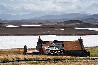 Dilapidated Lewis cottage with mountains of north Harris in background