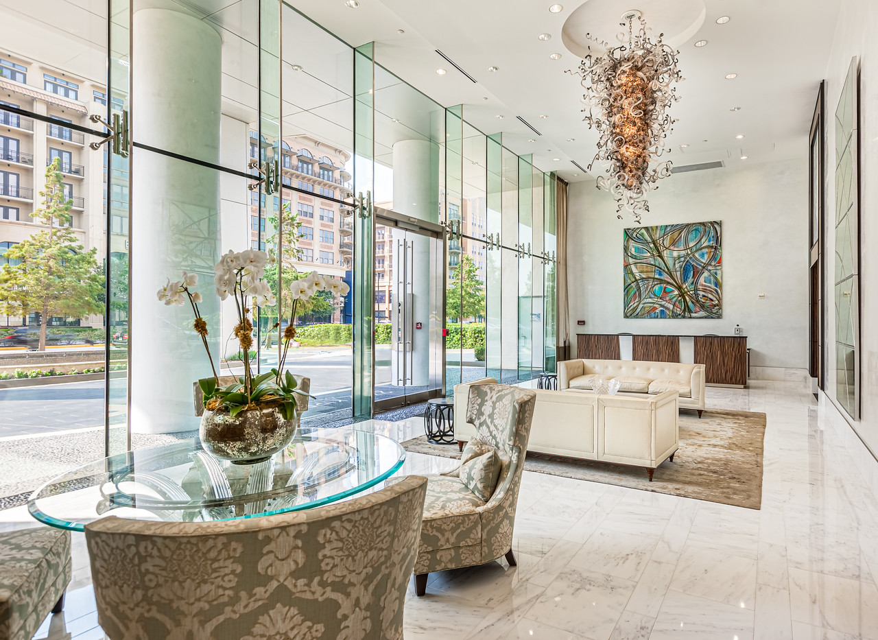 Beautiful Lobby with seating areas. A designer light fixture dominates the lobby.