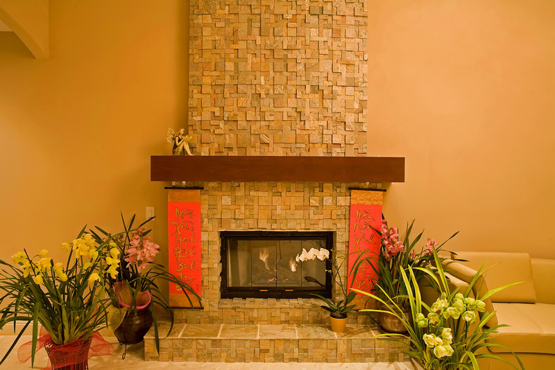 "The fireplace is customed built. The stone is ""Golden Ray"" slate stone and the mantel was built with Maple solid woods."