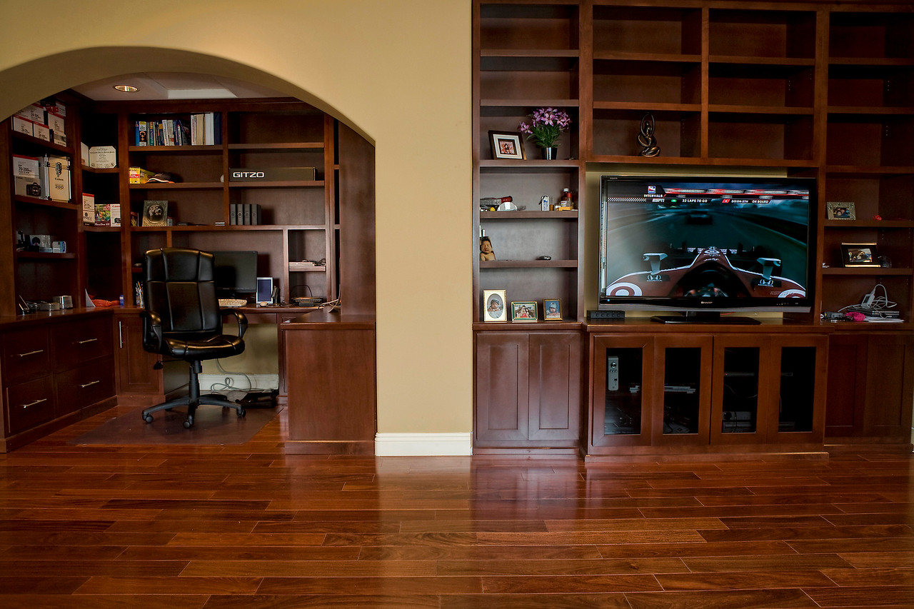 A view of the entertainment center and the office desk in the master bedroom upstairs. All the bedroom's floor are solid Santos Mahogany hardwood.
