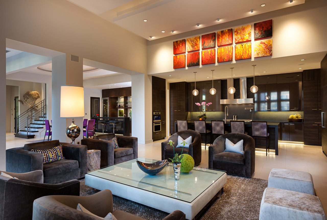 Modern Interior with Bar with brown barrel chairs and club chairs with white ottomans.