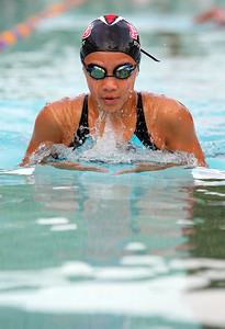 Vivian Zhu, a swimmer, competes in freestyle.