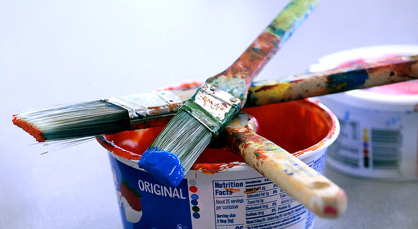 Some of the paint and brushes used to create the murals. Jon C. Hancock/for The Register-Herald