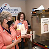 Delores Price, left, and Brenda Reed, volunteers for Beckley VA Medical Center, preparing popcorn for a $1 donation.<br /> (Rick Barbero/The Register-Herald)