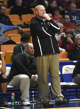 Fayetteville head coach Matt Boyd watches his team against Madonna, during the Class A quarter final game of the Boys State Basketball Tournament held at the Charleston Civic Center Wednesday morning. Madonna handed three-seed Fayetteville its first loss of the season 44-32, <br /> (Rick Barbero/The Register-Herald)