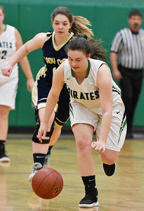 Fayetteville's (5) goes for a loose ball as Greenbrier West's (14) gives chase during their basketball game Tuesday in Fayetteville. (Chris Jackson/The Register-Herald)