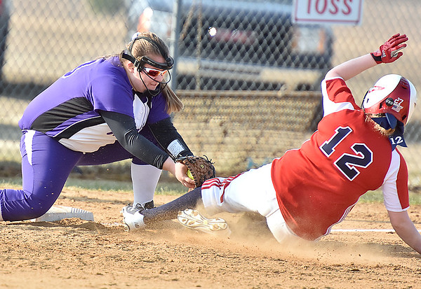 (Brad Davis/The Register-Herald) James Monroe 3rd baseman Savannah Sykes tags out Independence's #12 as she tries to advance during the Patriots' game against the Lady Mavs Friday evening in Coal City.