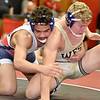 (Brad Davis/The Register-Herald) Independence's Sam Adams takes on Greenbrier West's John Parks in the 170-pound weight class championship match at the Coalfield Conference Invitational Saturday night in Oak Hill. Indy's Adams won the match.
