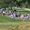 (Brad Davis/The Register-Herald) A hoard of fans follows along with leader and eventual champ Kevin Na's group during the Military Tribute at The Greenbrier Sunday afternoon in White Sulphur Springs.
