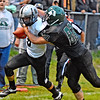 (Brad Davis/The Register-Herald) Westside's Dalton Estep, left, carries the ball as Wyoming East's Clay Lester tries to bring him down Friday night in New Richmond.