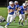 (Brad Davis/The Register-Herald) Midland Trail's Morgan Ferris dodges several Williamstown defenders as he carries up the sideline for a big kick return Friday night in Fairlea.