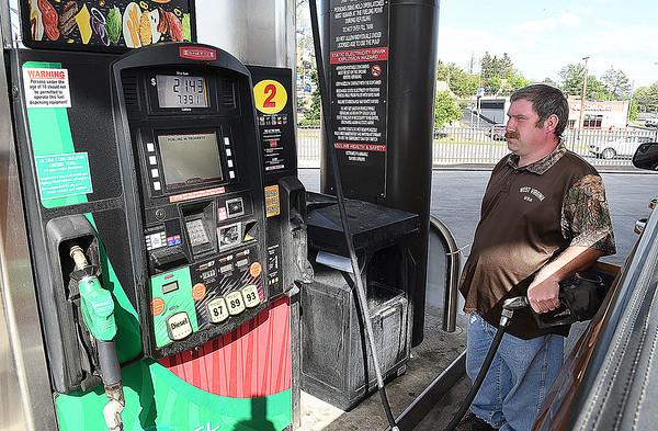 Dekek Howell, of Coal City, filling up at Sheets on Harper Road in Beckley.<br /> (Rick Barbero/The Register-Herald)