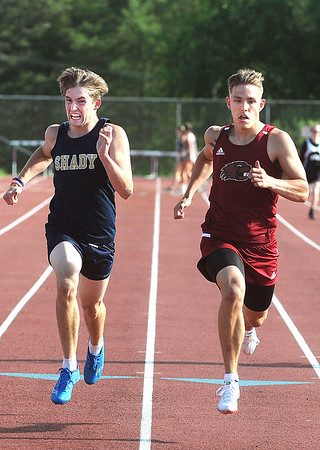 Shady's Jayden Straughn and Bluefield's Gaige Sisk compete in the 200 meter relay heat at Woodrow Wilson. Sisk finished first and Straughn second in the heat. Jon C. Hancock/for The Register-Herald