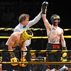 (Brad Davis/The Register-Herald) Phillip Whitely, right, is declared the winner as defending middleweight champion Michael Suttle, left, reacts to the judges' decision after being defeated during Original Toughman action Saturday night at the Beckley-Raleigh County Convention Center.
