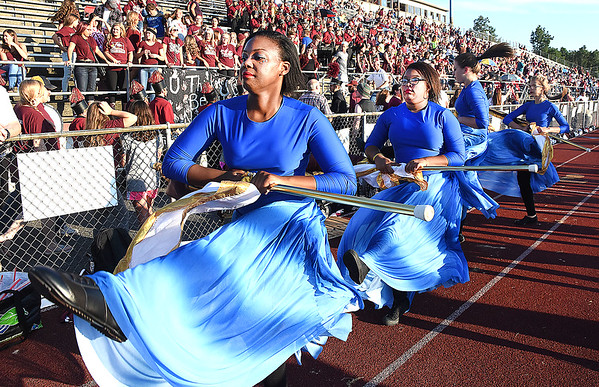 Woodrow Wilson color guard performing during game against Riverside High School at Van Meter Stadium in Beckley Friday night. (Rick Barbero/The Register-Herald)