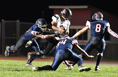 Ian Sloan, of Liberty, second from left, gets tackled by, Niko Burgess, left, Jacob Hatcher and Hunter Williams, of Independence during first half action at Independence High School Friday night. (Rick Barbero/The Register-Herald