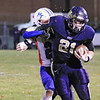 Greenbrier West's Noah Brown is tackled by Midland Trail's Seth Ewing during Friday night's game at Greenbrier West High School. (Jenny Harnish/The Register-Herald)