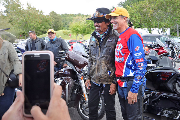 Fans take pictures of NASCAR's Richard Petty and Kyle Petty during a stop at the Canyon Rim Visitor Center in Lansing Thursday. The three-day Kyle Petty Charity Ride Revival is reuniting riders for scenic riding after more than two years apart due to the COVID-19 pandemic. The organization raises funds for Victory Junction and other charities that support chronically ill children.  Jenny Harnish/The Register-Herald