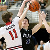(Brad Davis/The Register-Herald) Valley's Spencer Dean drives as Greater Beckley Christian's Jake O'Neal defends during the Class A Region 3 Co-Final Thursday night at the Beckley-Raleigh County Convention Center.