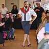 "(Brad Davis/The Register-Herald) Omar Khan owns his walk-on during the opening moments of the Hunks in Heels ""Fur"" Real fundraising event Friday night at the Beckley Moose Lodge."