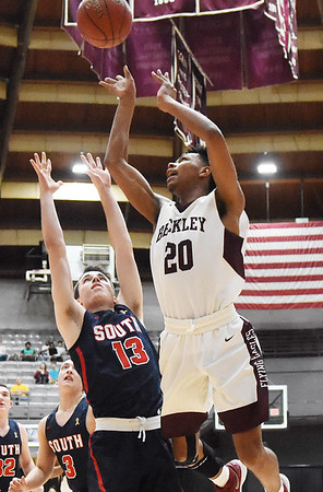 Woodrow Wilson's Mikey Penn (20) hits a quick shot over Parkersburg South's (13) during the first quarter of their basketball game in Beckley Tuesday. (Chris Jackson/The Register-Herald)