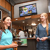 Melonie Seiler, left, and India Krawczyk waiting on their order at Coffee On Main on Main Street in Beckley. <br /> (Rick Barbero/The Register-Herald)