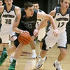 (Brad Davis/The Register-Herald) Wyoming East's Dylan Brehm hustles around Westside's Kenneth Bledsoe during the Class AA Region 3, Section 1 championship game Saturday night at the Beckley-Raleigh County Convention Center.