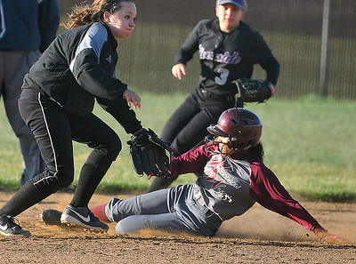 Brad Davis/The Register-Herald Speedy Woodrow Wilson left fielder Shailynn Lawson steals second base as James Monroe shortstop Kendall Marshall (left) fields the throw during a loss in the first game of a double-header against Riverside Thursday evening in Beckley.