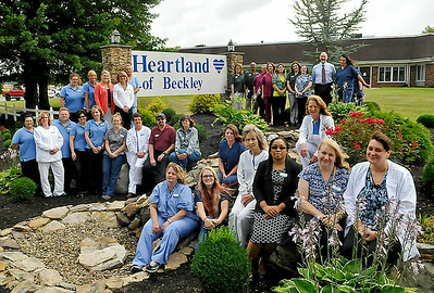 Brad Davis/The Register-Herald  The staff of Heartland of Beckley gathers for a group photo July 28 outside their location off Dry Hill Road.
