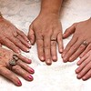 The hands of Zetta Underwood, 92, left, Margaret Williams, 70, Melissa Ryan, 47, Ashley Thomas, 26 and Karmyn Thomas, 5.<br /> (Rick Barbero/The Register-Herald)