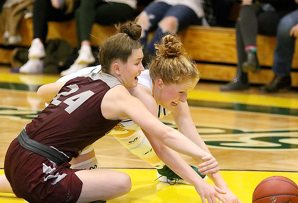 (Brad Davis/The Register-Herald) Woodrow Wilson's Liz Cadle and Greenbrier East's Kate Perkins scramble for a loose ball Saturday night in Fairlea.