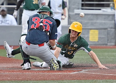 (Brad Davis/The Register-Herald) Miners baserunner Maddux Houghton slides and scores off a sacrifice fly to right from teammate Mason Washington as the throw bounces off Chillicothe catcher Dan McCauley Friday night at Linda K. Epling Stadium.