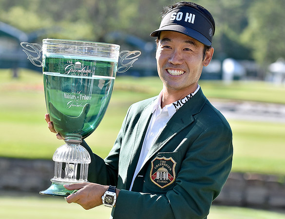 (Brad Davis/The Register-Herald) Kevin Na poses with the trophy after winning the Military Tribute at The Greenbrier Sunday afternoon in White Sulphur Springs.