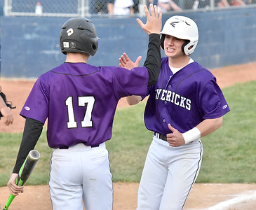 (Brad Davis/The Register-Herald) James Monroe's Xander Castillo, right, gets a high-five from teammate Ryker Brown as he crosses the plate to score a run after Shady Spring pitcher Justin Lovell's pickoff attempt to got away from 1st baseman Grant Davis during a 4-run 5th inning for the Mavericks' in a 5-2 win over the Tigers Wednesday evening in Shady Spring.