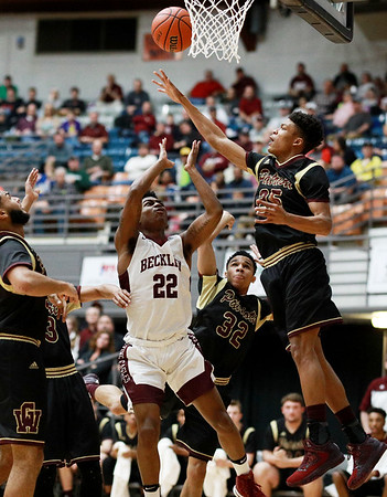 George Washington's (25) defends against an attempt by Woodrow Wilson's Isaiah Francis during their regional final Tuesday in Beckley. (Chris Jackson/The Register-Herald)