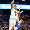 Oak Hill's Andrew Work (0) goes up for a layup over Robert C. Byrd's JT Sandy (14) <br /> during their West Virginia State Championship Class AA Quarter Finals in Charleston on Thursday. (Chris Jackson/The Register-Herald)