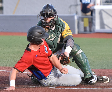 (Brad Davis/The Register-Herald) Champion City's Gage Taylor is stopped in his tracks by West Virginia catcher Sean David Clark as he tries to slide into home during the first inning of the Miners' game against the Kings Thursday night at Linda K. Epling Stadium.