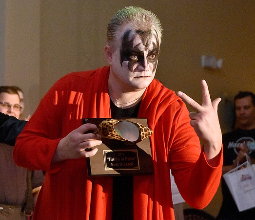 (Brad Davis/The Register-Herald) Mason Hannah at the conclusion of the annual Hunks in Heels fundraising event for the Women's Resource Center Friday night at the Beckley Moose Lodge.