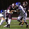 Maddex McMillen, of Woodrow Wilson, center, gets brought down by two Princeton defenders in the first half Friday night at VanMeter Stadium in Beckley.<br /> (Rick Barbero/The Register-Herald)