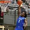 (Brad Davis/The Register-Herald) Team Jan-Care's (Class AA) Taevon Horton soars to the basket for a dunk against Team C. Adam Toney's (Class A) during the Scott Brown Classic Saturday night at the Beckley-Raleigh County Convention Center.