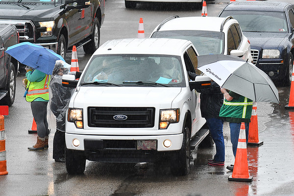 Vehicles lined up at the Beckley Raleigh County Convention Center receiving their COVID-19 vaccines.<br /> (Rick Barbero/The Register-Herald)